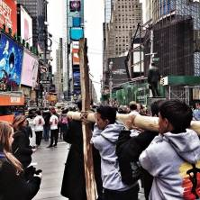 Mission Youth carrying the cross through Times Square on Good Friday