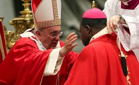 Pope Francis investing an Archbishop with the pallium